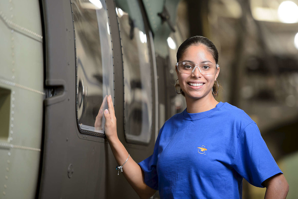 Aerospace Assembly Line Worker poses for a portrait as part of an annual report campaign