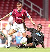Photo: Daniel Hambury<br /> Coca-Cola Championship.<br /> West Ham United V Wigan Athletic 15/08/2004<br /> <br /> West Ham's Tomas Repka and Wigan Athletic's Nathen Ellington