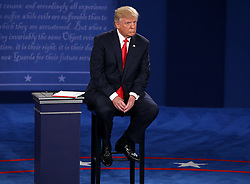 Donald Trump listens as Hillary Clinton addresses the crowd during the second debate between the Republican and Democratic presidential candidates on Sunday, October 9, 2016 at Washington University in St. Louis, Mo. Photo by Christian Gooden/St. Louis Post-Dispatch/TNS/ABACAPRESS.COM