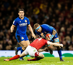 Niccolo Cannone of Italy under pressure from Johnny McNicholl of Wales<br /> <br /> Photographer Simon King/Replay Images<br /> <br /> Six Nations Round 1 - Wales v Italy - Saturday 1st February 2020 - Principality Stadium - Cardiff<br /> <br /> World Copyright © Replay Images . All rights reserved. info@replayimages.co.uk - http://replayimages.co.uk