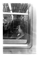 Femme endormie dans le metro de Tokyo, Japon. 1987<br />Woman fast asleep, Tokyo subway, Japan. 1987