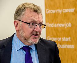Pictured: David Mundell eyed the menu at the entrance and one entry appeared to catch his eye<br /> <br /> Scottish Secretary David Mundell visited a 'digital garage' in Edinburgh which trains people in digital skills. The Google Digital Garage, in Shandwick Place is a social responsibility outlet for the corporate giant<br /> Ger Harley | EEm 23 July 2018