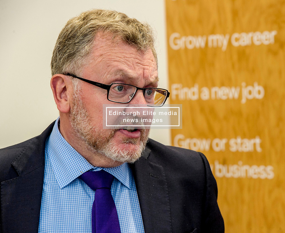 Pictured: David Mundell eyed the menu at the entrance and one entry appeared to catch his eye<br /> <br /> Scottish Secretary David Mundell visited a 'digital garage' in Edinburgh which trains people in digital skills. The Google Digital Garage, in Shandwick Place is a social responsibility outlet for the corporate giant<br /> Ger Harley   EEm 23 July 2018
