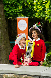Pictured: Saim Sarwar (8), Harris Binnie (8) and Naeema Ahmd Aran (8) were having fun with the crazy hats.<br /> Pupils from Royal Mile Primary tried  on crazy hats made by a performer from company Mischief Labas, which is holding a hat-making workshop at the Imaginate opening weekend on May 28-29<br /> <br /> <br /> <br /> Ger Harley | EEm 26 May 2016