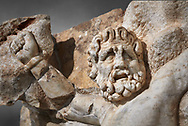 Detail of a Roman Sebasteion relief sculpture of Zeus and Prometheus, Aphrodisias Museum, Aphrodisias, Turkey.    <br /> <br /> Prometheus is screaming in pain. Zeus had given him a terrible punishment for giving fire to man: he was tied to the Caucasus mountains and had his liver picked out daily by an eagle. Herakles shot the eagle and is undoing the first manacle. He wears his trade mark lion-skin and thrown his club to one side. A small mountain nymph, holding a throwing stick appears amongst the rocks. .<br /> <br /> If you prefer to buy from our ALAMY STOCK LIBRARY page at https://www.alamy.com/portfolio/paul-williams-funkystock/greco-roman-sculptures.html . Type -    Aphrodisias     - into LOWER SEARCH WITHIN GALLERY box - Refine search by adding a subject, place, background colour, museum etc.<br /> <br /> Visit our ROMAN WORLD PHOTO COLLECTIONS for more photos to download or buy as wall art prints https://funkystock.photoshelter.com/gallery-collection/The-Romans-Art-Artefacts-Antiquities-Historic-Sites-Pictures-Images/C0000r2uLJJo9_s0
