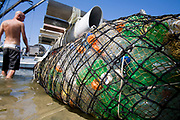 "In tf 2008, the raft called ""Junk""  will sail 2,100 miles from Los Angeles through the North Pacific Gyre, on raft made of junk, it is  constructed from 20,000 plastic bottles, an airplane fuselage, discarded fishing nets, a solar generator, and a bicycle generator. Long Beach, California, USA"