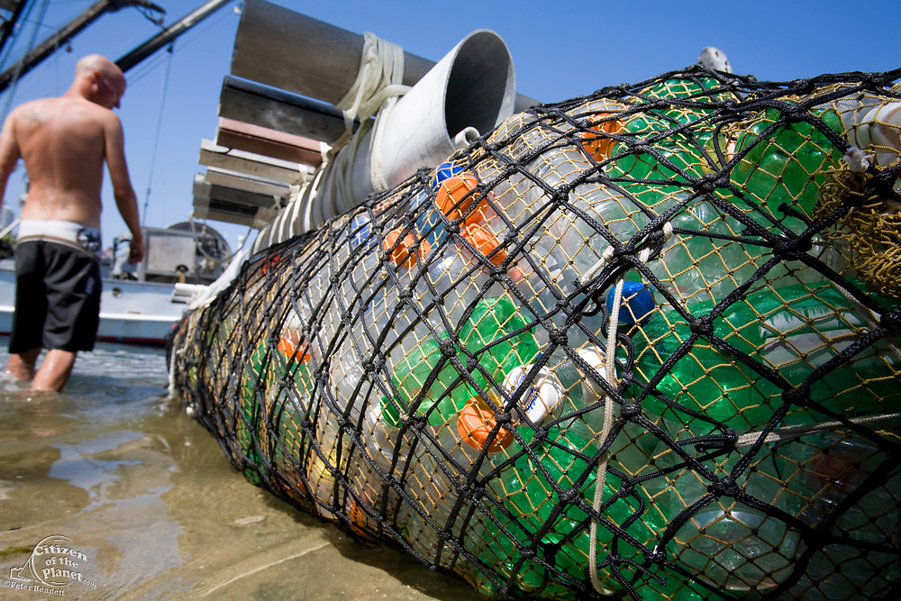 """In tf 2008, the raft called """"Junk""""  will sail 2,100 miles from Los Angeles through the North Pacific Gyre, on raft made of junk, it is  constructed from 20,000 plastic bottles, an airplane fuselage, discarded fishing nets, a solar generator, and a bicycle generator. Long Beach, California, USA"""