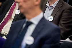 © Licensed to London News Pictures. 19/02/2018. London, UK. Badges worn at the launch event for Renew, a new anti-Brexit political party, at the Queen Elizabeth II Conference Centre in London. The Renew party, which is taking advice from representatives of Emmanuel Macron's En Marche, has recruited some 220 candidates to stand in local and national elections. Photo credit: Ben Cawthra/LNP