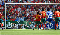 OPORTO PORTUGAL 12/06/04 PORTUGAL V GREECE EURO 2004<br />GEORGIOS KARAGOUNIS (GREECE) BEATSW RICARDO TO SCORE OPENING GOAL<br />photo Roger Parker Fotosports International