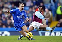 26/12/2004 - FA Barclays Premiership - Chelsea v Aston Villa - Stamford Bridge<br />Aston Villa's Nolberto Solano fouls Chelsea's Arjen Robben<br />Photo:Jed Leicester/Back Page Images