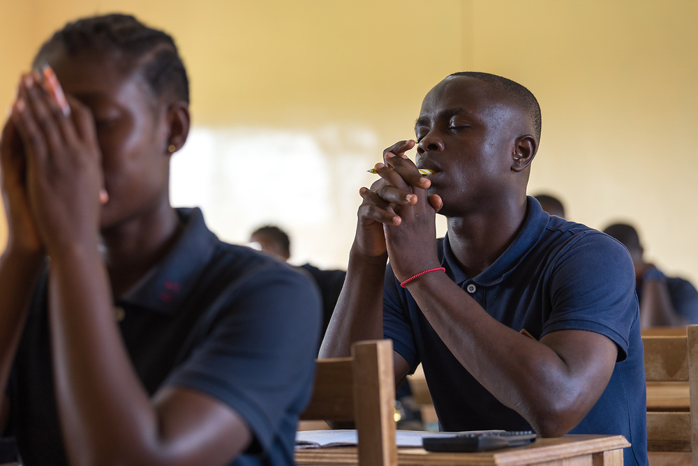 4 November 2019, Vriginia, Liberia: Students share a moment of prayer at the beginning of English class at Ricks Institute. The Liberia Baptist Convention runs Ricks Institute, a day and boarding school for currently 496 students from kindergarten up through 12th grade.