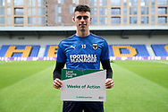 AFC Wimbledon goalkeeper Nikola Tzanev (13) holding level playing field sign  during the EFL Sky Bet League 1 match between AFC Wimbledon and Gillingham at Plough Lane, London, United Kingdom on 23 February 2021.