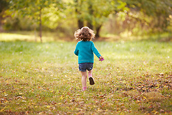 Rear view of Young Girl Running in Park