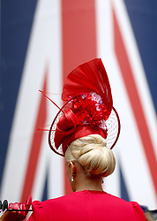 A fashionable racegoer during day five of Royal Ascot at Ascot Racecourse.