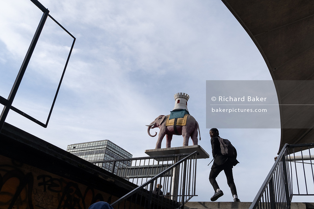 On the day that Elephant & Castle Shopping Centre closes before its demolition and redevelopment, south Londoners pass the iconic Elephant symbol is outside the mall before doors are locked for the final time after 55 years, on 24th September 2020, in south London, England. The much-criticised architecture of the Elephant & Castle Shopping Centre was opened in 1965, built on the bomb damaged site of the former Elephant & Castle Estate, originally constructed in 1898. The centre was home to restaurants, clothing retailers, fast food businesses and clubs where south Londoners socialised and met lifelong partners.