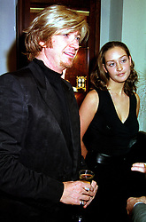 Hairdresser NICKY CLARKE and MISS OCTAVIA COATES, at a party in London on 8th November 2000.OIW 91