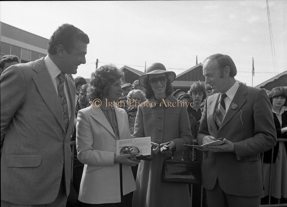 Irish Distillers Grand National at Fairyhouse.  (M66)..1979..16.04.1979..04.16.1979..16th April 1979..The Irish Distillers Grand National was run today at Fairyhouse Racecourse, Co Meath.The race over 3.5miles is valued at £20,000. the winning trainer will also receive the Tom Dreaper,Perpetual Trophy which will be presented by Mrs Betty Dreaper..Image shows Mr Richard Burrows, M D Irish Distillers ltd, Mrs Burrows, Mrs O'Kennedy and Minister for Foreign Affairs, Mr Michael O'Kennedy having a day at the races in Fairyhouse, Co Meath.