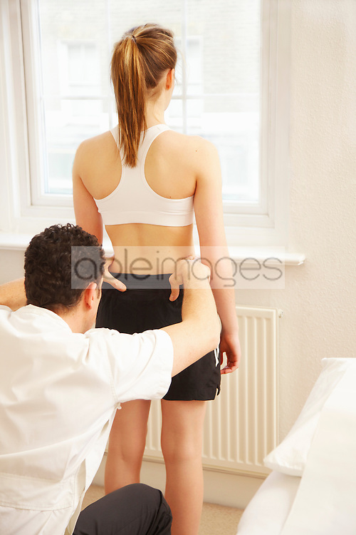 Osteopath Treating Female Patient