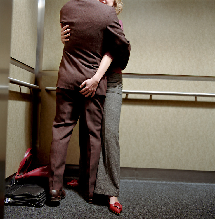 Man and woman embracing in elevator