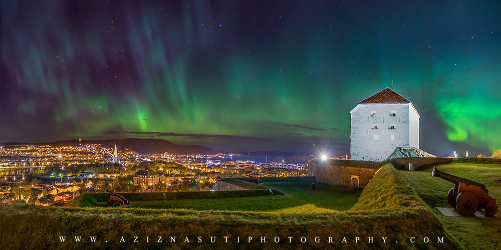 A very beautiful night over TRondheim. View from  Kristiansten Festnin. Kristiansten Festning, historically spelled Christiansten) is located on a hill east of the city of Trondheim in Sør-Trøndelag county, Norway. It was built after the city fire of Trondheim in 1681 to protect the city against attack from the east. Construction was finished in 1685. It fulfilled its purpose in 1718 when Swedish forces laid siege against Trondheim. The fortress was decommissioned in 1816 by king Charles XIV John. Please feel free to check my photos here or find me by: |Website| ,