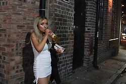 © Licensed to London News Pictures. 17/04/2021. Liverpool, UK. A reveller finishes her drink as she enjoys the first weekend in Liverpool city centre after lockdown restrictions were eased Photo credit:  Ioannis Alexopoulos/LNP