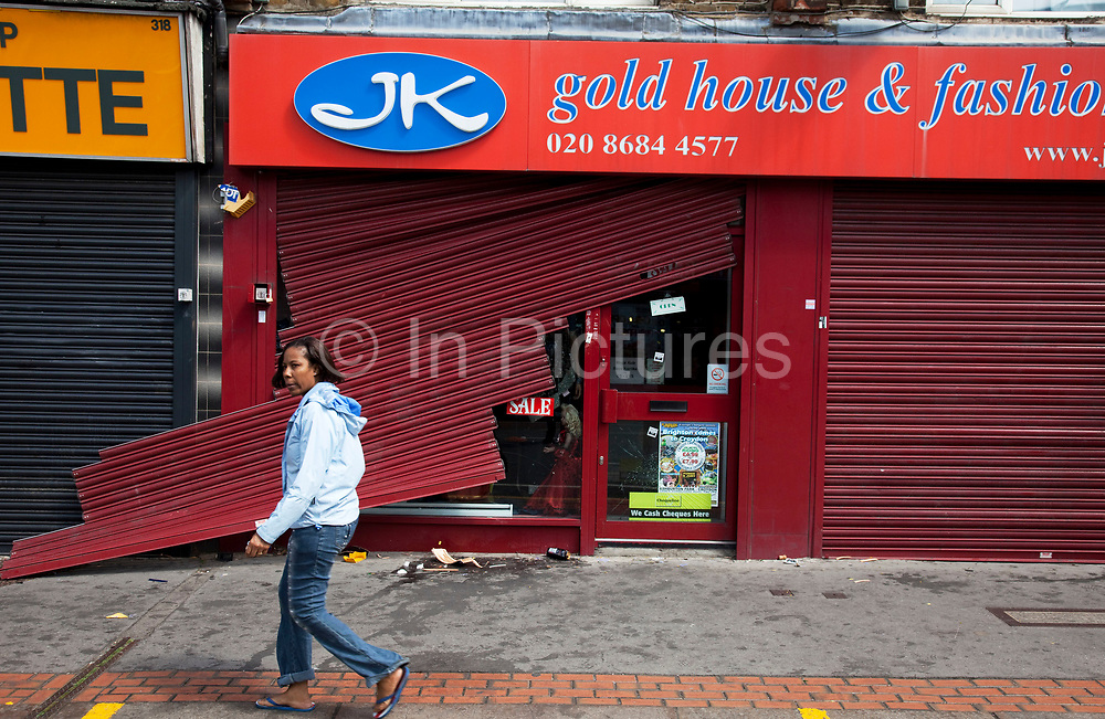 Looted and smashed up shop fronts along London Road in Croydon. The day after rioting took place in Croydon in South London. Riots flared for a third night in a row, resulting in burnt out buildings, looted shops and general smashed up devastation.