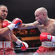 Luis Collazo (R) lands a right hand to the face of Keith Thurman during their Premier Boxing Champions boxing match for the WBA Welterweight title on ESPN at the USF Sun Dome, on Saturday, July 11, 2015 in Tampa, Florida.  Thurman won the bout when the corner of Collazo stopped the fight at the beginning of the eighth round. (AP Photo/Alex Menendez)