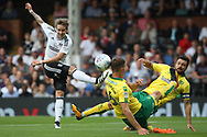 Fulham Midfielder Stefan Johansen (L) takes a shot at goal but sees it blocked by Norwich City Defender Christoph Zimmermann (c). EFL Skybet football league championship match, Fulham  v Norwich city at Craven Cottage in London on Saturday 5th August 2017.<br /> pic by Steffan Bowen, Andrew Orchard sports photography.