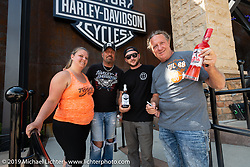 Kelli and Alex Noland of SD had bottles of spirits signed by Jesse James Dupree, lead vocalist of Jackyl (and part of the Full Throttle Saloon and Jesse James Bourbon) and Michael Ballard of the Full Throttle Saloon at the Harley-Davidson Rally Point on the corner of Main and Harley-Davidson Way during the Sturgis Black Hills Motorcycle Rally. SD, USA. Saturday, August 10, 2019. Photography ©2019 Michael Lichter.