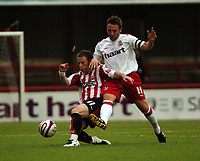 Photo: Tony Oudot.<br /> Brentford v Lincoln City. Coca Cola League 2. 27/10/2007.<br /> Glenn Poole of Brentford is challenged by Scott Kerr of Lincoln