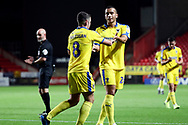 AFC Wimbledon midfielder Anthony Hartigan (8) celebrating after scoring goal to make it 0-1 during the EFL Trophy match between Charlton Athletic and AFC Wimbledon at The Valley, London, England on 4 September 2018.