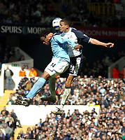 Photo: Ed Godden.<br />Tottenham Hotspur v Manchester City. The Barclays Premiership. 08/04/2006. Kiki Musampa (L) collides with Spurs' Jermaine Jenas.