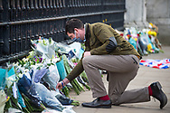 A member of the public lays a bunch of flowers in memory of Prince Philip The Royal Highness the Duke of Edinburgh, London on 9 April 2021.