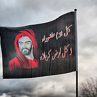 LONDON, ENGLAND - DECEMBER 27:  An Imam Hussein flag waves during the Ashura procession from Marble Arch to Holland Park Mosque on December 27, 2009 in London, England. Ashura is a 10 day period of mourning for Imam Hussein, the seven-century grandson of Prophet Mohammad who was killed in a battle in Karbala in Iraq, in 680 AD.  (Photo by Marco Secchi/Getty Images)