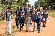 The team of volunteers head out on a community outreach day knocking on doors and completing surveys as part of the ICS Raleigh SWASH (school water, sanitation and hygiene plan) project. Mbulu, Manyara district, Tanzania. Working in partnership with the Diocese of Mbulu Development Department (DMDD); part of Caritas Tanzania.