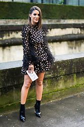 Camila Coelho is seen on the street attending Valentino during Paris Women's Fashion Week A/W 2018 wearing Valentino on March 4, 2018 in Paris, France. (Photo by Nataliya Petrova/NurPhoto/Sipa USA)