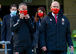 DUBLIN, REPUBLIC OF IRELAND - Sunday, October 11, 2020: Wales' manager Ryan Giggs (L) and head of public affairs Ian Gwyn Hughes (R), wearing face masks, during the UEFA Nations League Group Stage League B Group 4 match between Republic of Ireland and Wales at the Aviva Stadium. The game ended in a 0-0 draw. (Pic by David Rawcliffe/Propaganda)