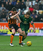 Photo: Andrew Unwin.<br />Hull v Norwich City. Coca Cola Championship. 11/02/2006.<br />Norwich's Darren Huckerby (R) holds off Hull's Keith Andrews.