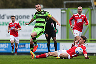 Forest Green Rovers Liam Noble(15) is tackled by Wrexham's Martin Riley(5) during the Vanarama National League match between Forest Green Rovers and Wrexham FC at the New Lawn, Forest Green, United Kingdom on 18 March 2017. Photo by Shane Healey.