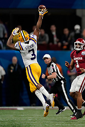 JaCoby Stevens #3 of the LSU Tigers bats down a pass by Jalen Hurts #1 of the Oklahoma Sooners during the first half of the 2019 College Football Playoff Semifinal at the Chick-fil-A Peach Bowl on Saturday, Dec. 28, in Atlanta. (Paul Abell via Abell Images for the Chick-fil-A Peach Bowl)