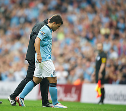 19.08.2012, Etihad Stadion, Manchester, ENG, Premier League, Manchester City vs FC Southampton, 1. Runde, im Bild Manchester City's Sergio Aguero walks off injured against Southampton during the English Premier League 1st round match between Manchester City and Southampton FC at the Etihad Stadium, Manchester, Great Britain on 2012/08/19. EXPA Pictures © 2012, PhotoCredit: EXPA/ Propagandaphoto/ David Rawcliff..***** ATTENTION - OUT OF ENG, GBR, UK *****