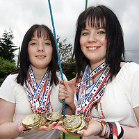 14-07-05<br /> 12 year old twins Francesca (right) and Johanna pictured at their home in Whitegate with their collection of 16 gold and 2 silver medals.<br /> Pic Arthur Ellis/Press22.