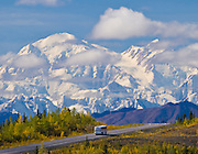 Bus on the Parks Hwy in Alaska  with Mt McKinley  behind.