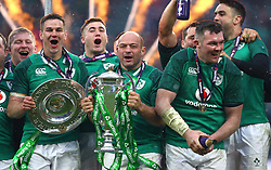 Ireland's Rory Best celebrates with the trophy after winning the grand slam during the NatWest 6 Nations match at Twickenham Stadium, London.