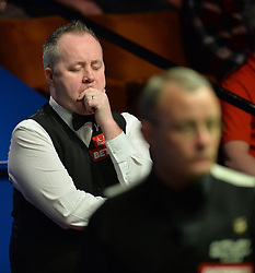 John Higgins shuts his eyes in his match against Martin Gould on day four of the Betfred Snooker World Championships at the Crucible Theatre, Sheffield.