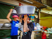 03 FEBRUARY 2019 - BANGKOK, THAILAND: Workers carry stewed ducks to a shop in Bangkok's Chinatown. Chinese New Year celebrations in Bangkok start on February 4, 2019. The coming year will be the Year of the Pig in the Chinese zodiac. About 14% of Thais are of Chinese ancestry and Lunar New Year, also called Chinese New Year or Tet is widely celebrated in Chinese communities in Thailand.          PHOTO BY JACK KURTZ
