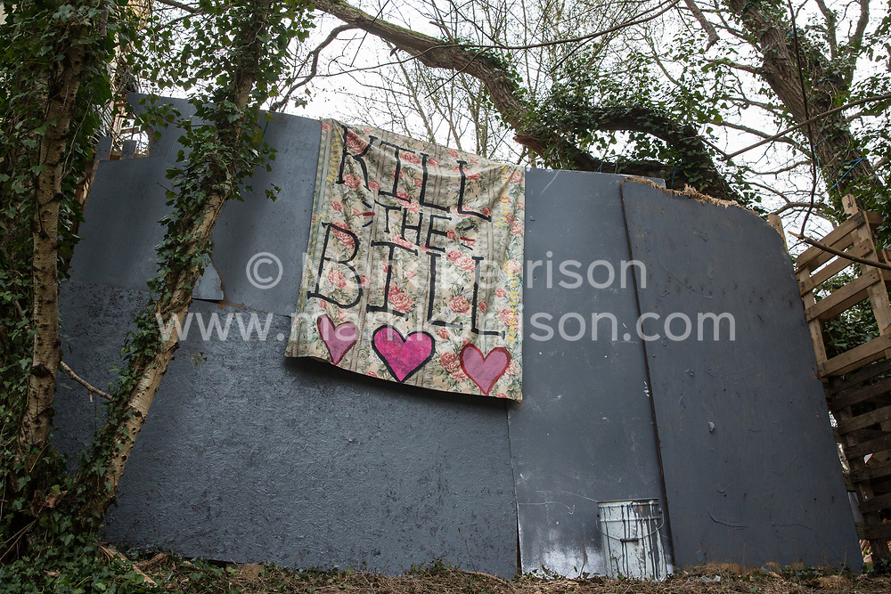A Kill The Bill banner hangs from a wall of the Wendover Active Resistance Camp, which is occupied by activists opposed to the HS2 high-speed rail link, on 9th April 2021 in Wendover, United Kingdom. Tree felling work for the project is now taking place at several locations between Great Missenden and Wendover in the Chilterns AONB, including directly opposite Wendover Active Resistance Camp.