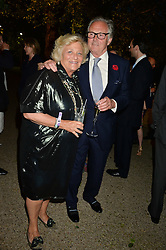 DAME VIVIEN DUFFIELD and LORD HINDLIP at a dinner hosted by Cartier in celebration of The Chelsea Flower Show held at The Hurlingham Club, London on 19th May 2014.