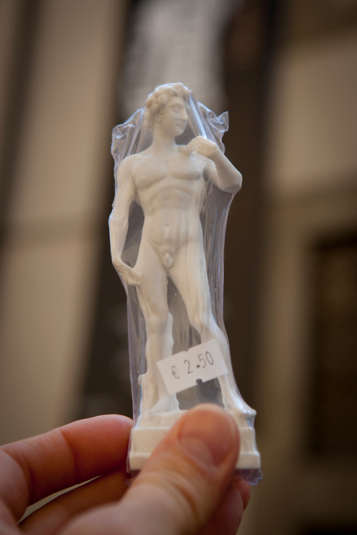 Miniature souvenir in plastic of the Michelangelo masterpiece sculpture of David. The Galleria dell'Accademia