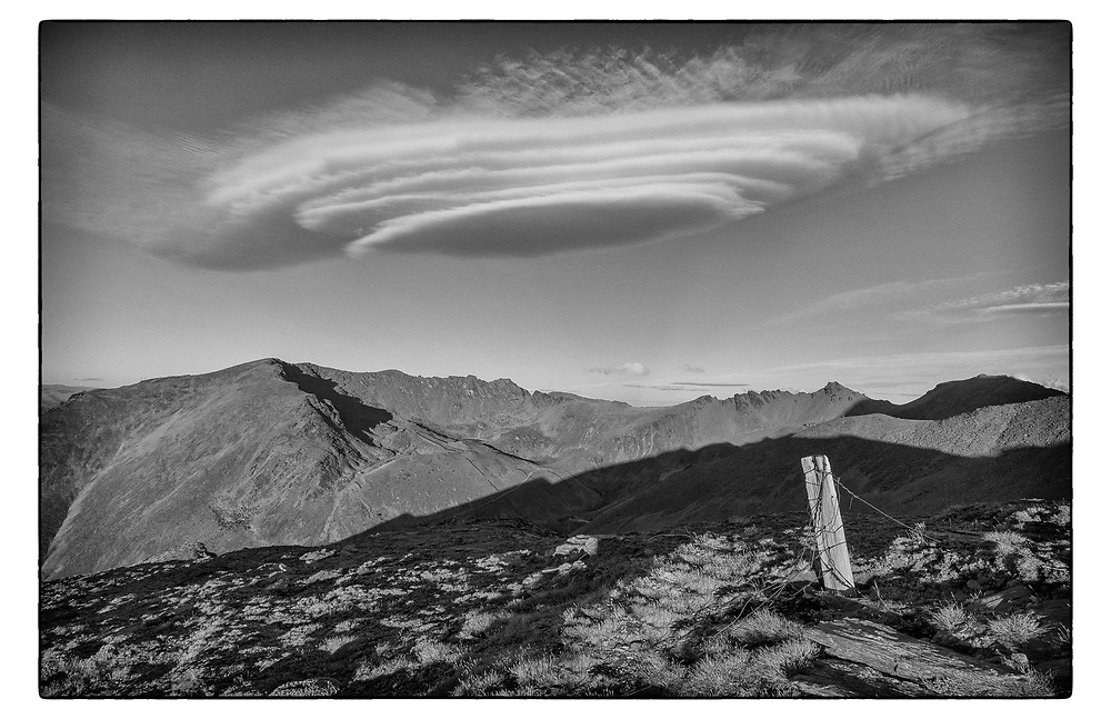 Lenticular clouds above The Remarkables. Queenstown. Otago.